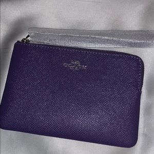 Coach purple corner zip wristlet
